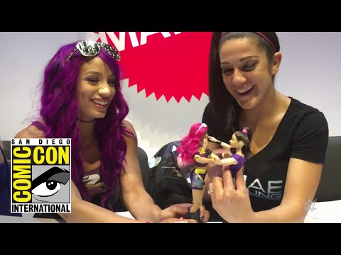 Sasha Banks and Bayley play with their new WWE Superstars dolls