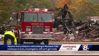 Massive mill fire smolders day after, slowing investigation