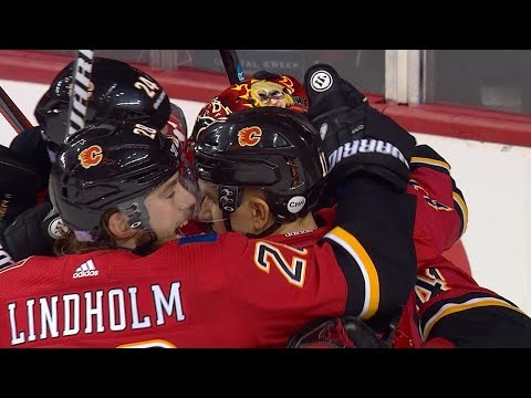 Flames erupt for five straight goals in 3rd period to stun Avalanche