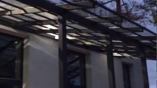 Навес из монолитного поликарбоната над террасой.