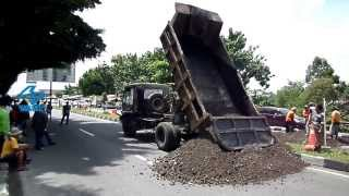 Dump Truck Fuso Unloading Sand in Middle of Road
