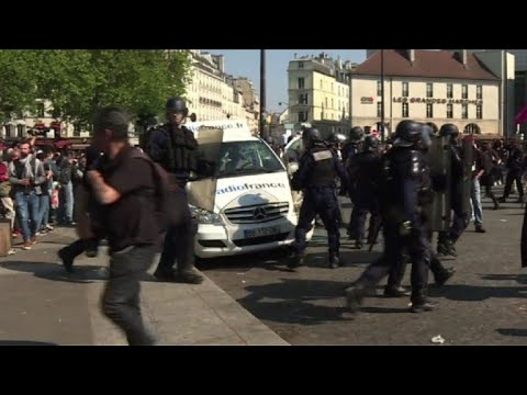 Press van vandalised at anti-Macron protest in Paris