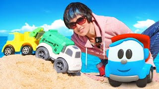 Мусоровоз машинки и кран на пляже Мультик Грузовичок Лёва Весёлая школа Капуки Кануки