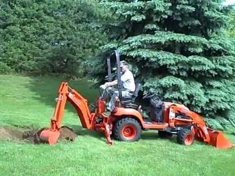 Kubota Bx25 Digging Out Dogwood Stump Youtube