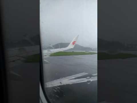 Air China B737-800 CA118 rainy takeoff at Hong Kong International Airport