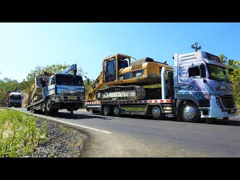 Excavator And Dozer Heavy Equipment Transport By Self Loader Truck