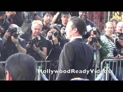 Jon Hamm arrives at Disney's Million Dollar Arm premiere at El Capitan in Hollywood