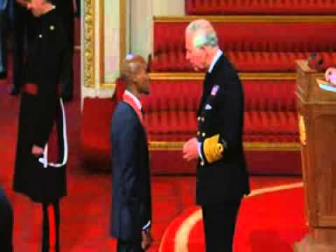 Olympian Mo Farah Receives CBE At Palace