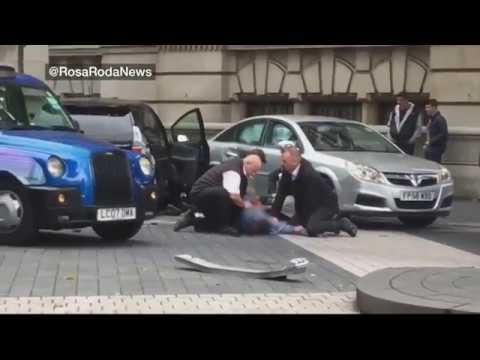 Man pinned to floor outside museum - BBC News