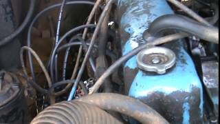 Changing points, condenser, plugs, wires, coil, and vacuum advanced