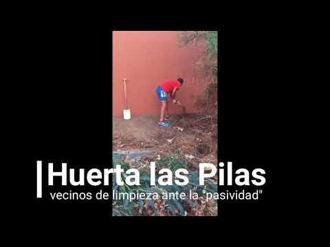 Vecinos limpian su barrio ante la pasividad municipal en Huerta Las Pilas