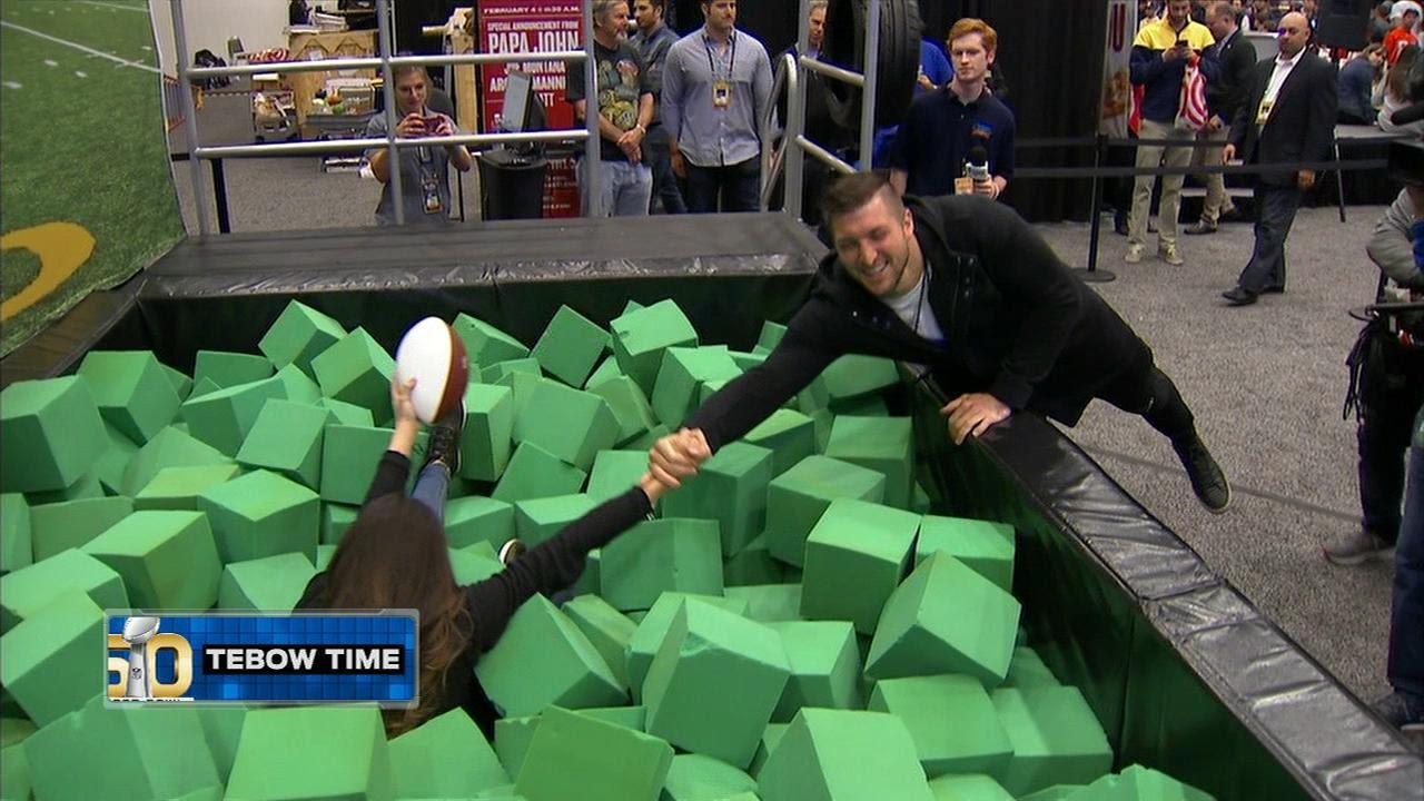 Tim Tebow hangs with Katie Nolan at Super Bowl 50