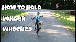 How to wheelie a mountain bike for a long time
