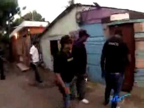 Foto-crónica: La DNCD, bajo música urbana y allanamientos