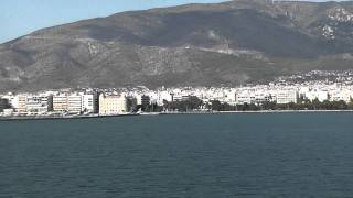 views of the city of Volos as we approach by ferry boat.Greece