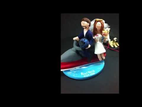 jet-skiers-towing-dogs-wedding-cake-topper