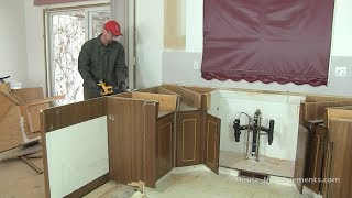 Shannon from http://www.house-improvements.com/ shows you how to remove kitchen cabinets. In this case, the entire kitchen is
