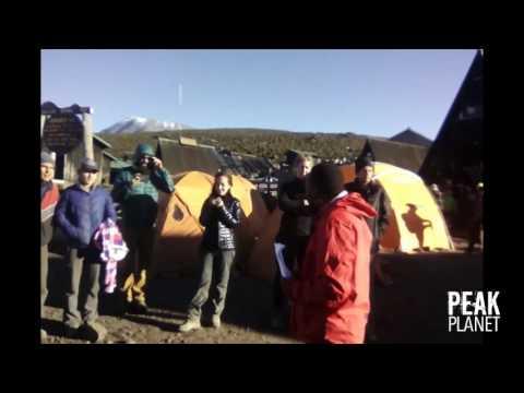 The Oldest Person To Climb Kilimanjaro Celebrates With Peak Planet Crew