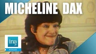 Micheline Dax chez elle avec son chat | Archive INA
