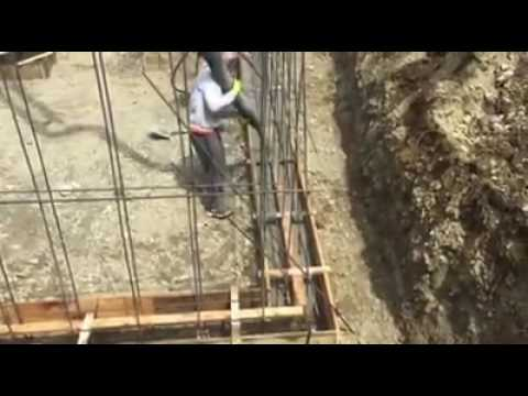 Foundation contractors pouring the footing