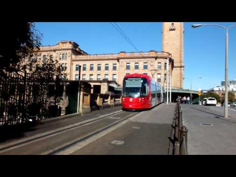 Sydney Light Rail tram set departs Sydney Central railway station