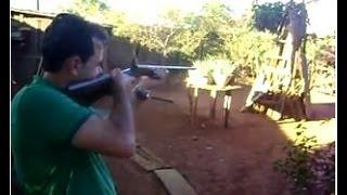 Tiro espingarda calibre 32