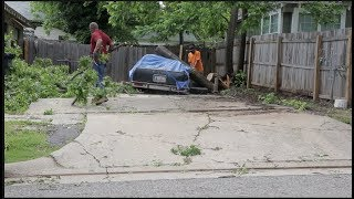 Businesses and residents near NW 23rd & Classen clean up after storms