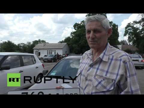 Ukraine: Donetsk locals swap Ukrainian license plates for DPR registration