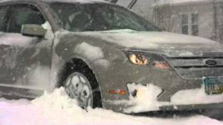 Video clip of car stuck in snow spinning it