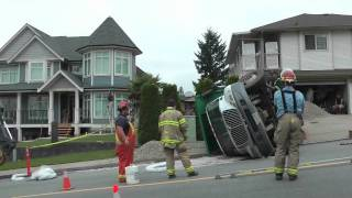 DUMP TRUCK ROLLOVER ON MARMONT ST IN COQUITLAM AUG 5 2011 COPYRIGHT BCNEWSVIDEO.m4v