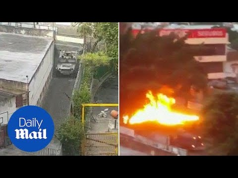 Explosions seen as tanks crash into residential areas in Caracas - Daily Mail