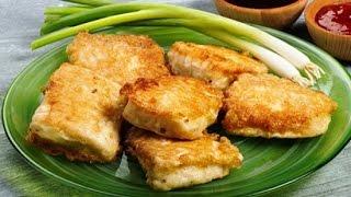 Рыба морская филе хека жареная на сковороде в кляре