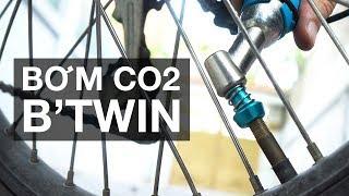 Trên tay ống bơm CO2 của B'Twin cho xe đạp - nhỏ gọn, tiện lợi