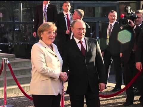 Vladimir Putin Meets Angela Merkel Chancellor of Germany