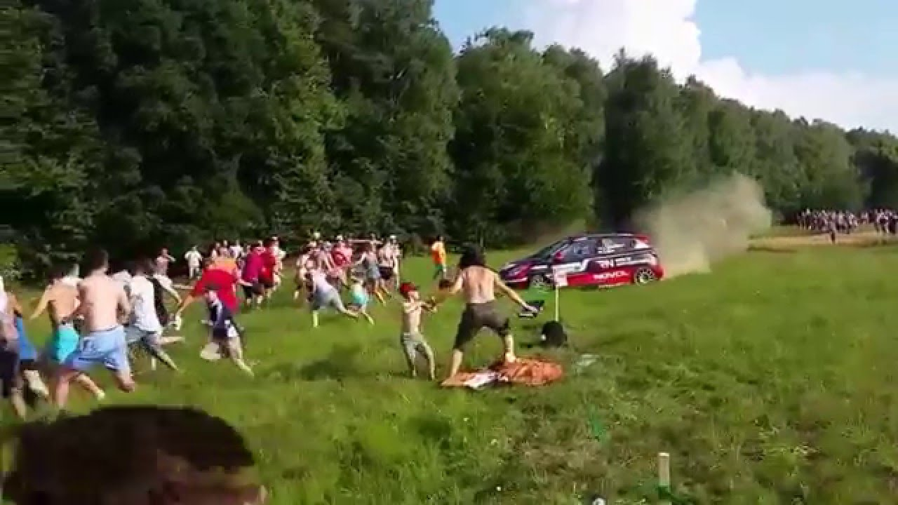 Close shave! Dad drags his son away from out-of-control rally car