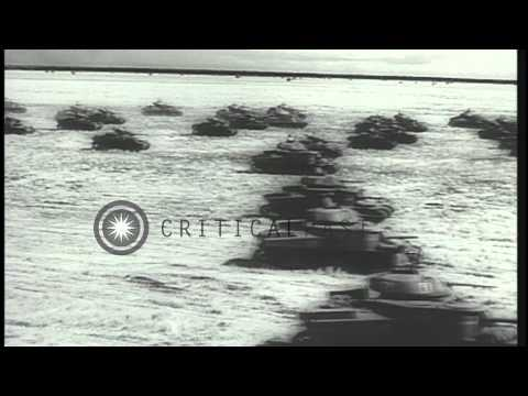 Bombs being dropped over United States Land Lease tanks during a maneuver in Aust...HD Stock Footage