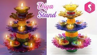 Diya Stand from Plastic Spoons & Glitters By Sonali's Creations
