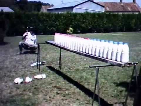 taurus raging bull 50 mag guns vs bottles beretta 92 fs 9 mm sw p 645 45 acp ruger redhawk
