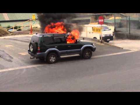 Car Fire - put out with tiny fire extinguisher