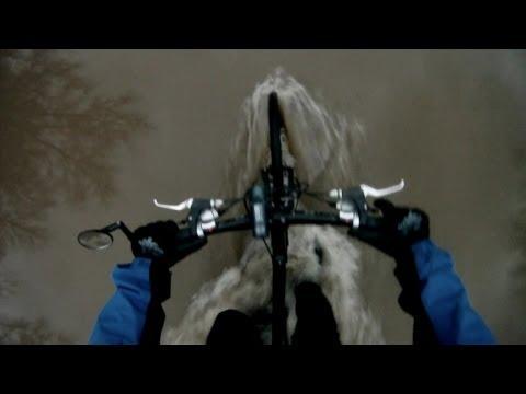 Stupid Cyclist Rides Through Flooded Bike Path