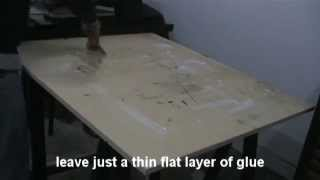 applying table adhesive for screenprint