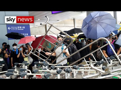 Protesters set fire to barricades to block access to Hong Kong airport