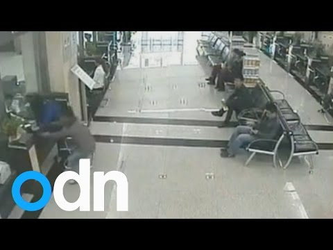 Thief caught swiping woman's money from bank counter