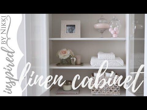 linen-cabinet-styling- -simple-organization- -ikea-glass-door-cabinet