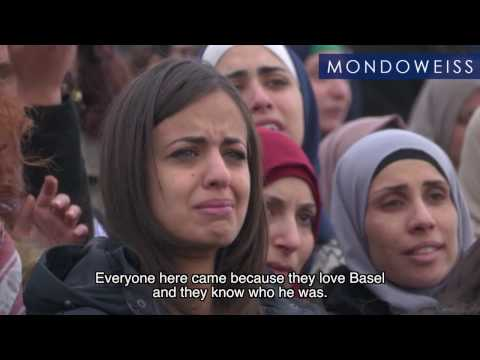 Thousands attend funeral of political activist shot and killed by Israeli forces