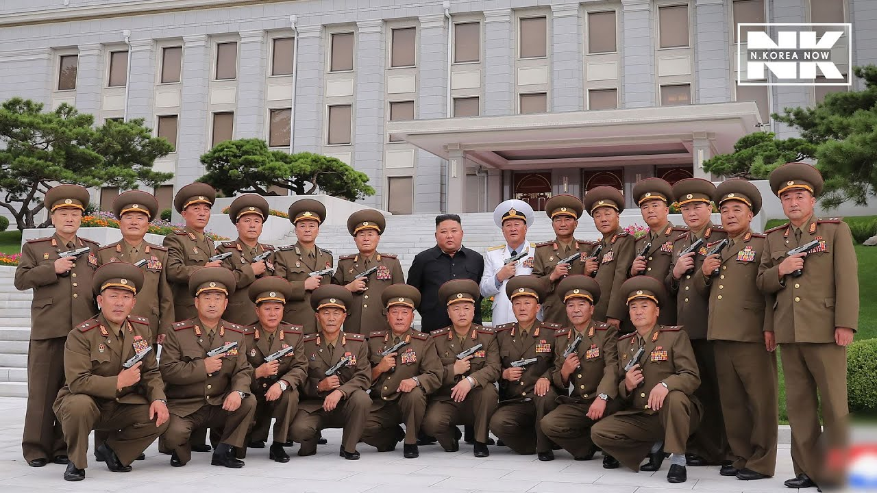 North Korean leader Kim Jong-un surrounded by pistols
