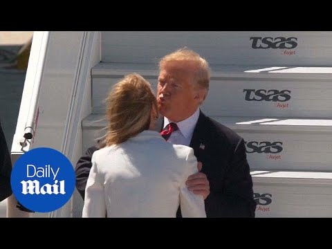 Trump awkwardly greets ambassador as he arrives for G7 summit