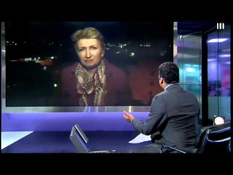 Libya gunfire interrupts live Channel 4 News TV report