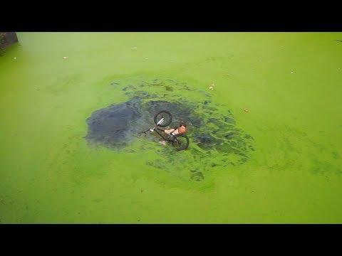 LEVENSGEVAARLIJKE SPRONG MET BMX IN IJSKOUD GIFTIG WATER !!!!