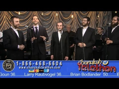 Comedian MODI introducing the SHIRA CHOIR at Chabad Telethon